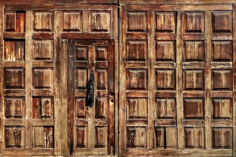 Old wooden door of the house. Vintage background. Old wooden door of the house. Vintage background royalty free stock images