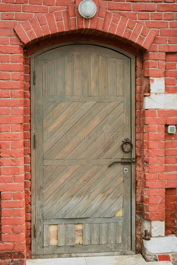 old wooden door with a lantern above it royalty free stock image