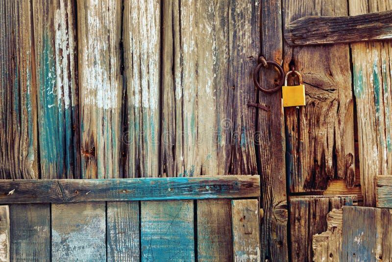 Old wooden door with lock stock photo