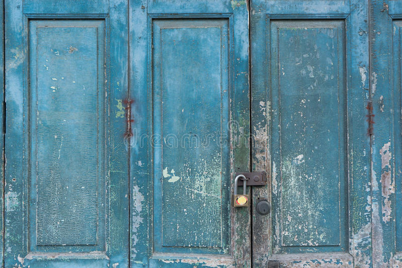 Old wooden door. Lock from outside royalty free stock images
