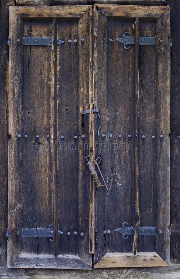 Old wooden door with locker royalty free stock images