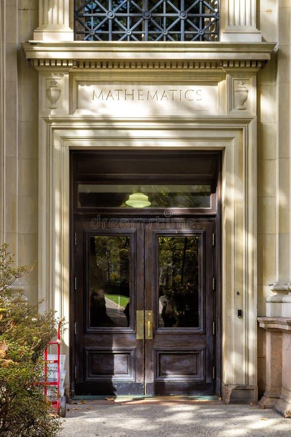 Old wooden door of mathematics faculty in Clolumbia University stock images