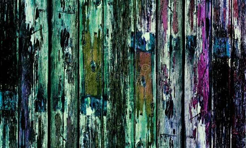 Old wooden door with multi-coloured paint. Multi coloured old wooden door with flakey multi-coloured paint royalty free stock photo