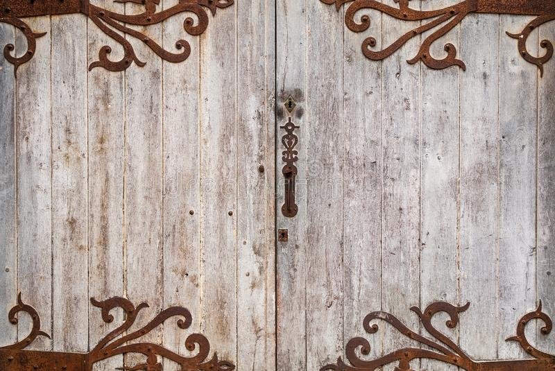 Old wooden door with nice detailed background stock photo