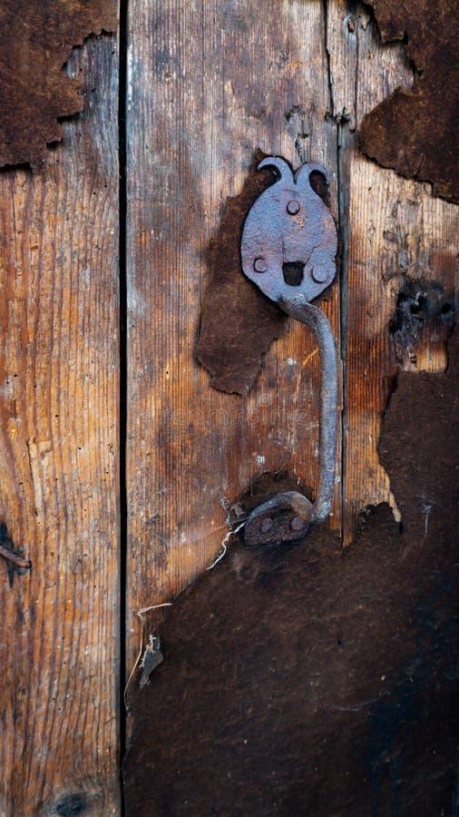 Old door with an rarity door handle stock image