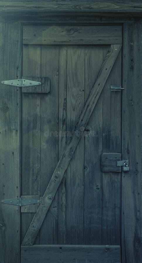 Old wooden door with padlock stock photo