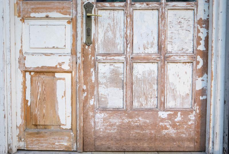 Old Wooden door peeling color texture rusty house background stock photography