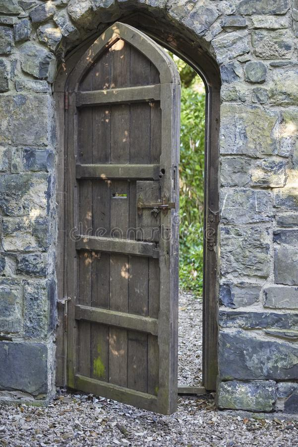 Old wooden door with stone frame stock photos
