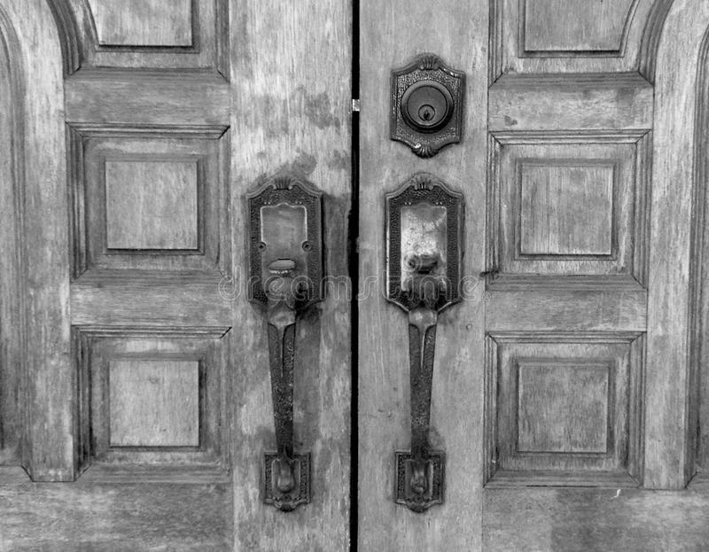Old wooden door with rusty latch, black and white stock images