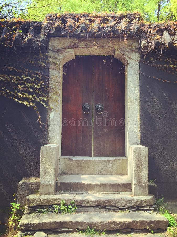 Old wooden door with staircase stock photo