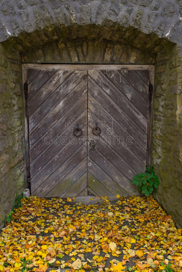 Old wooden door, and stone wall royalty free stock photography