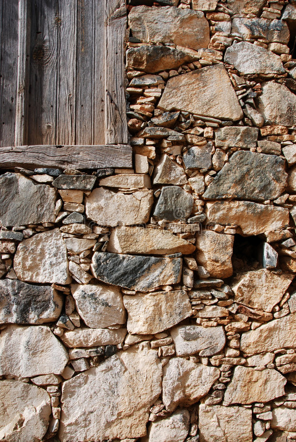 Download Old Wooden Door On A Stoned Wall Stock Photo - Image: 4885416