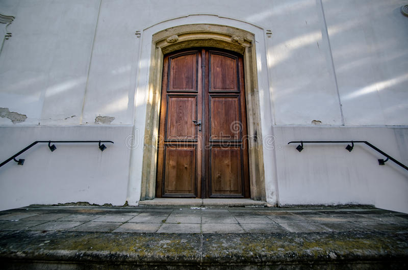 Old wooden door to the church royalty free stock photo