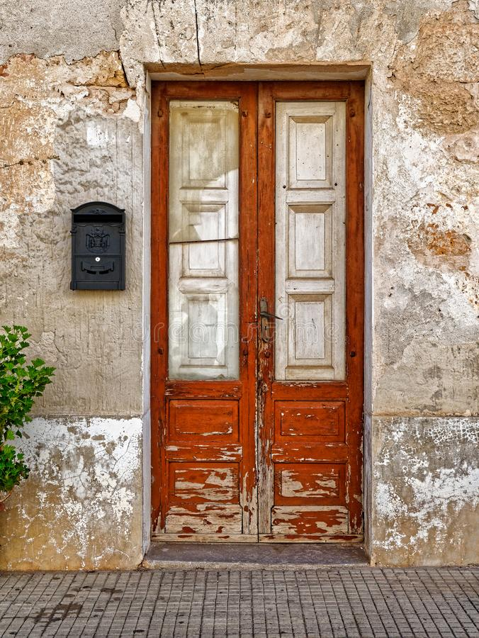 Old wooden door in the wall.  stock photography
