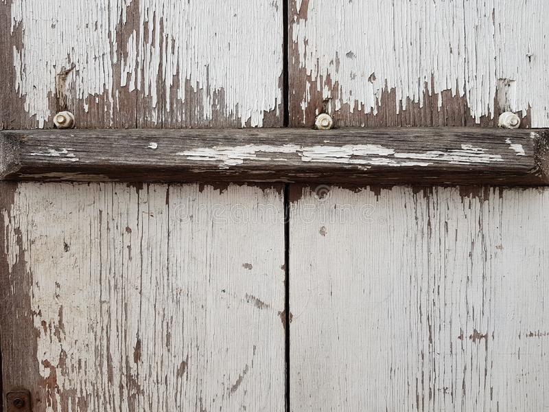 Old wooden door with white shabby paint and slat.  royalty free stock photos
