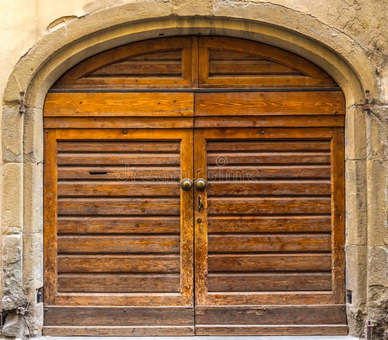 An old wooden doors, element of Italian architecture stock photography