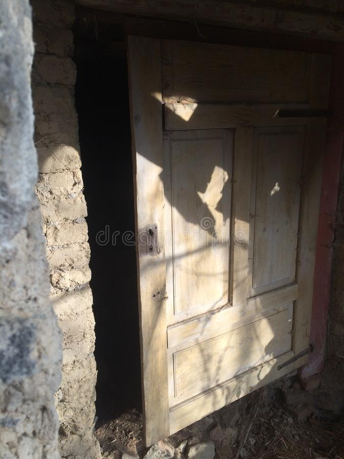 Old wooden doors. And emty object. EMT. Shadow in the middle royalty free stock images