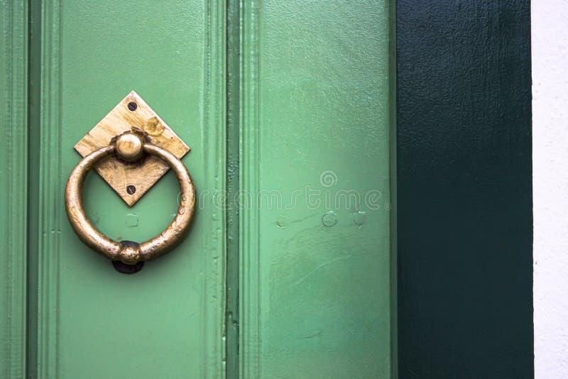 Old wooden doors with an old metal door handle. Knocker royalty free stock photo