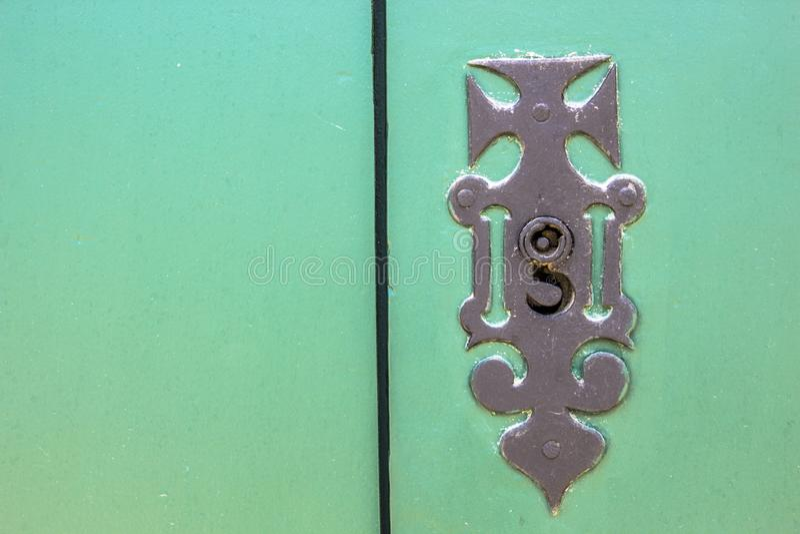 Old wooden doors with an old metal door handle knocker. In Paraty colonial city stock photo