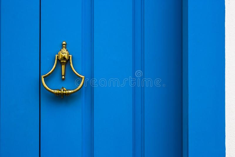 Old wooden doors with an old metal door handle royalty free stock image