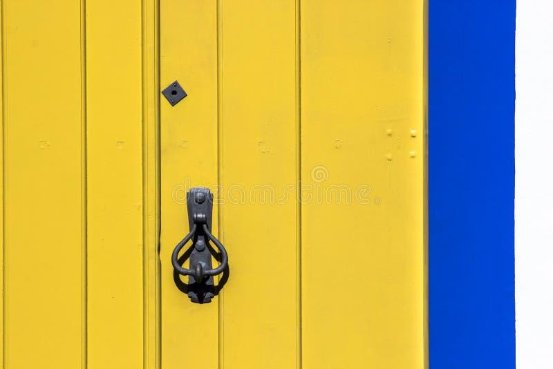 Old wooden doors with an old metal door handle. Knocker stock image