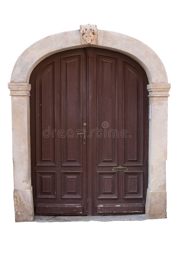 Old wooden doors with stone frame isolated on white background. Clipping path royalty free stock photography
