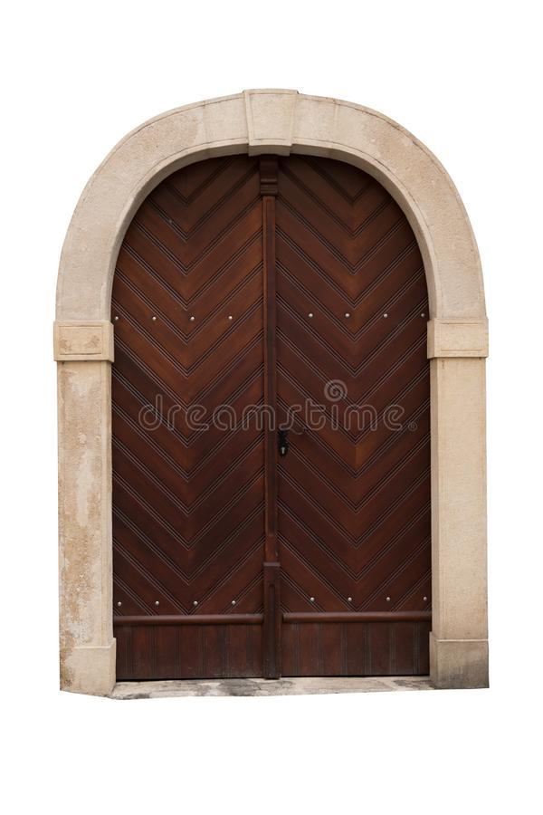 Old wooden doors with stone frame isolated on white background. Clipping path stock photo