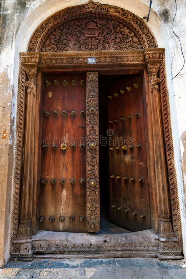 Old wooden doors in Stone Town, Zanzibar. Close up traditional obsolete wooden door in Stone Town, ZAnzibar stock photos