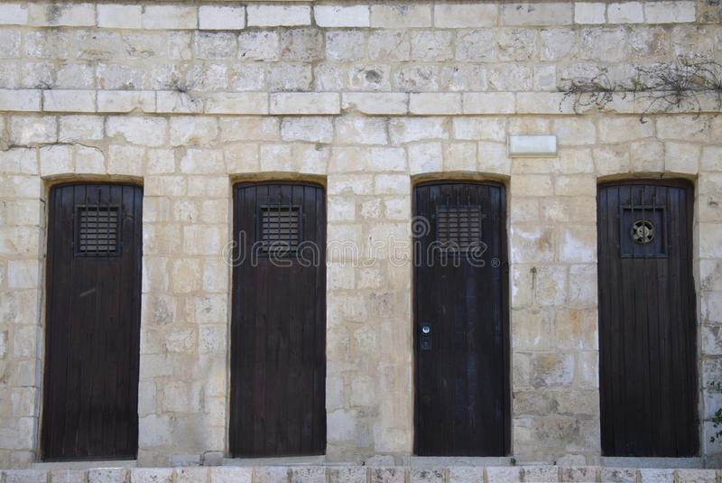 Download Old Wooden Doors In Stone Wall Stock Image - Image: 25830311