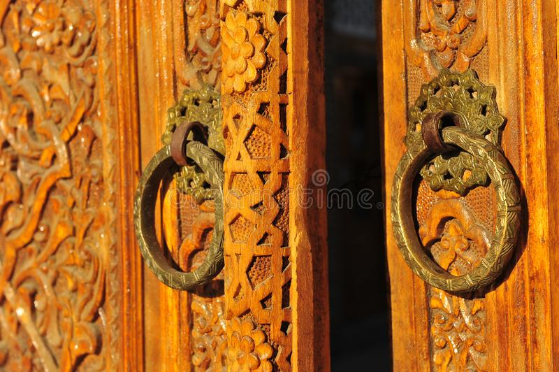 Old wooden doors with traditional arabic pattern. The Old wooden doors with traditional arabic pattern stock images