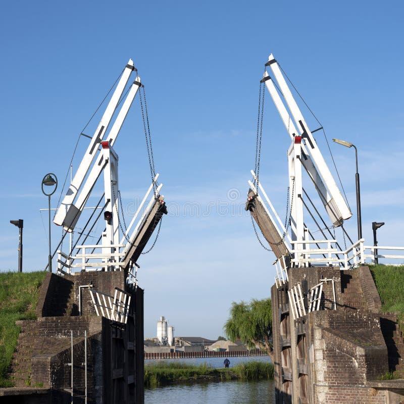 Old wooden drawbridge at entrance to harbour schoonhoven on river lek stock photo