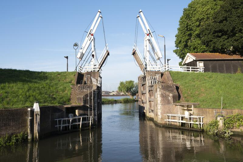 Old wooden drawbridge at entrance to harbour schoonhoven on river lek royalty free stock photography