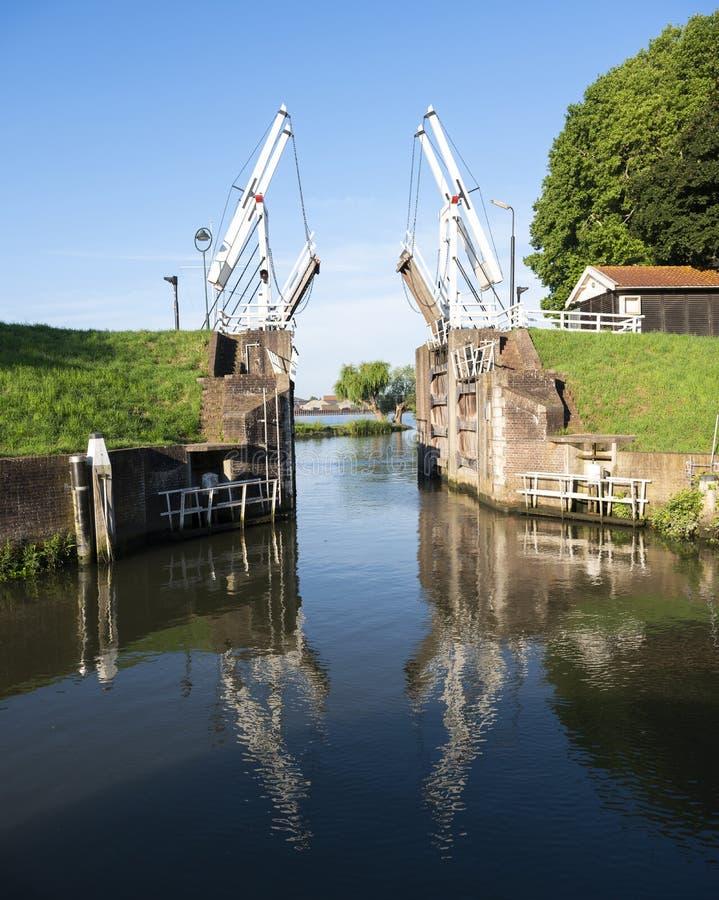Old wooden drawbridge at entrance to harbour schoonhoven on river lek stock images