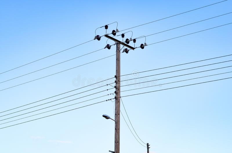 Old wooden electricity  and  telephone pylon royalty free stock photography