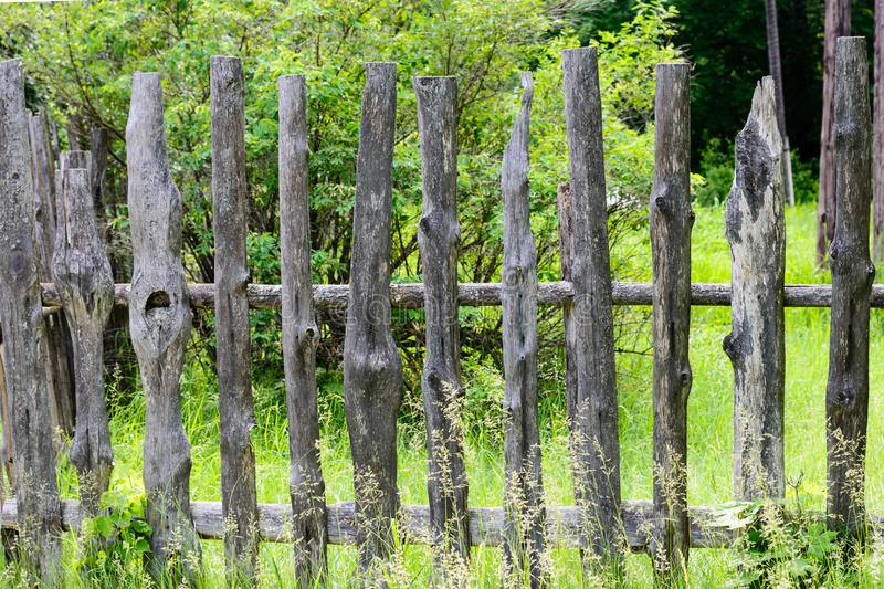 Old wooden fence enclosing bee apiary summer. Russia stock photography
