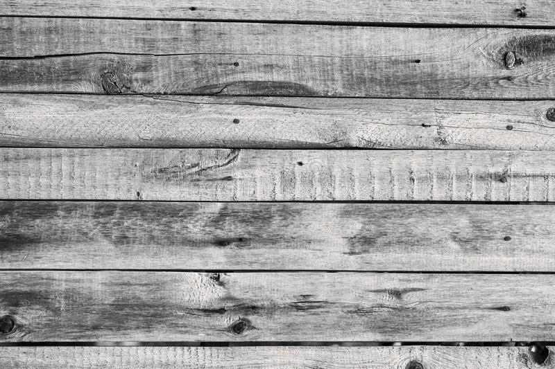 Old wooden fence rotten texture boards. Background.  royalty free stock photo