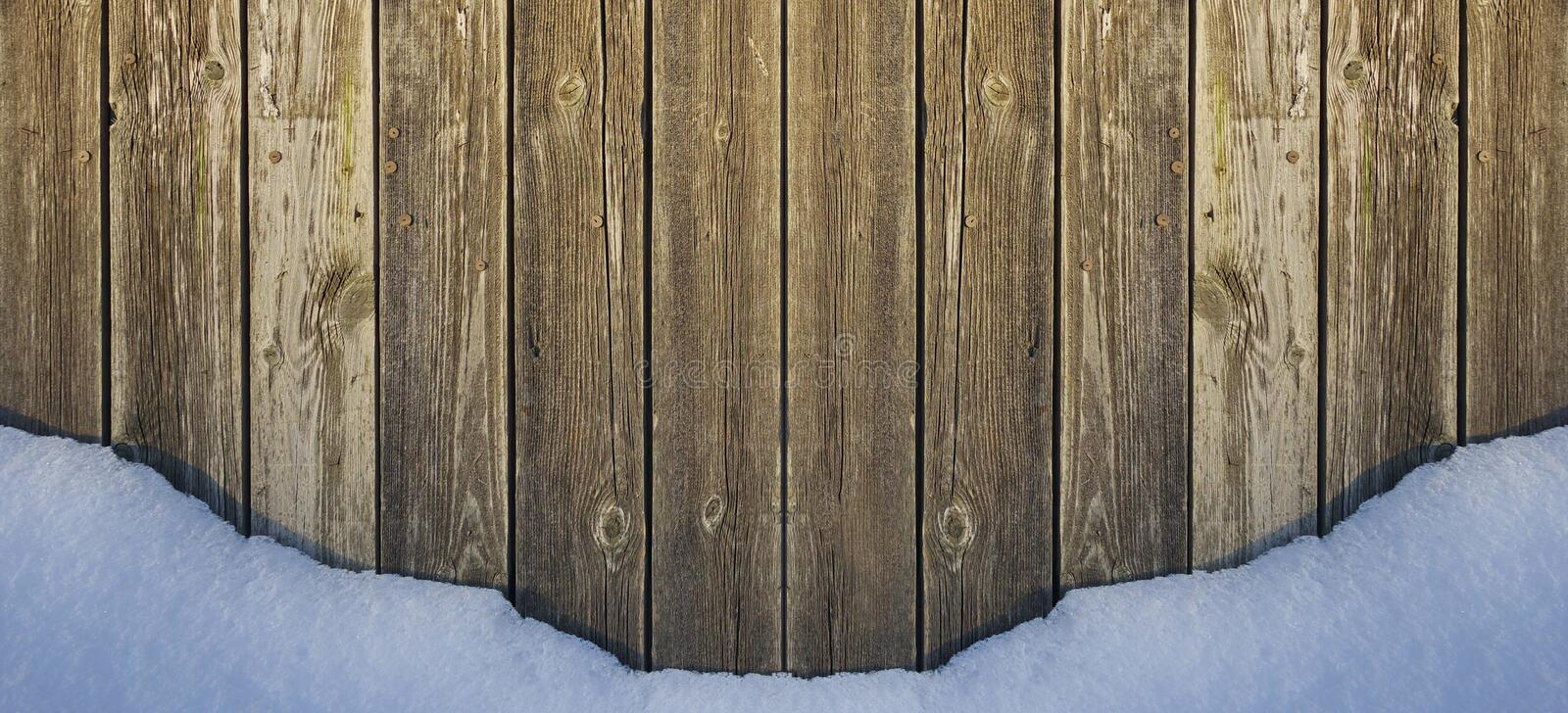 Old wooden fence and white snow border holiday Christmas or new year place for text. Old wooden fence and white snow border for web design holiday Christmas or royalty free stock photos