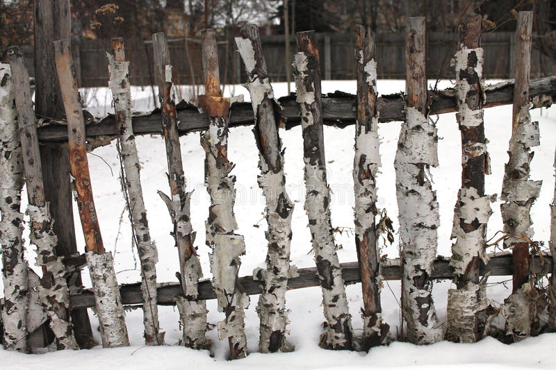 Old wooden fence in winter stock image