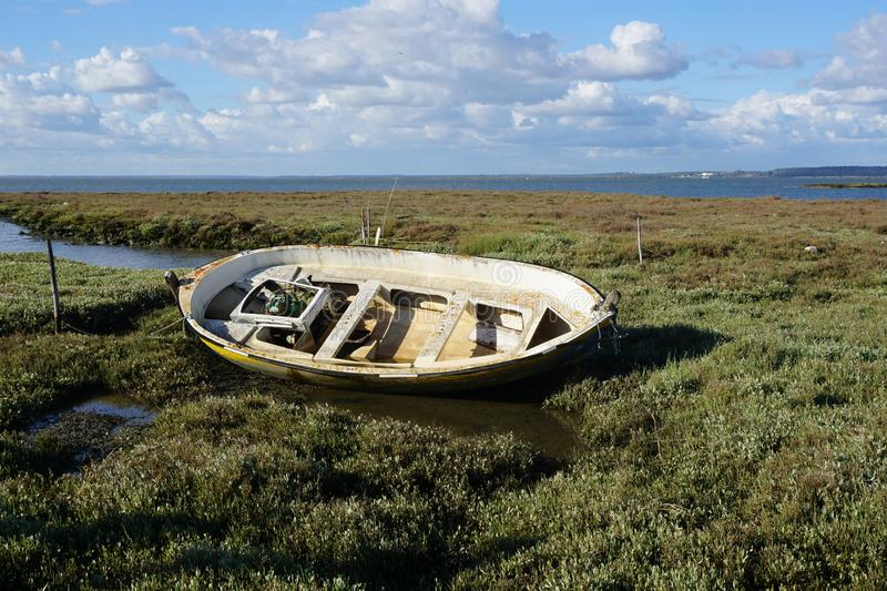 Old wooden fishing boat abandoned by the river royalty free stock photography