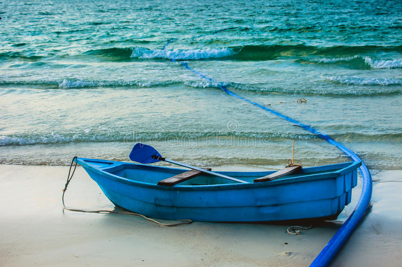 Old wooden fishing boat. On the beach stock photo