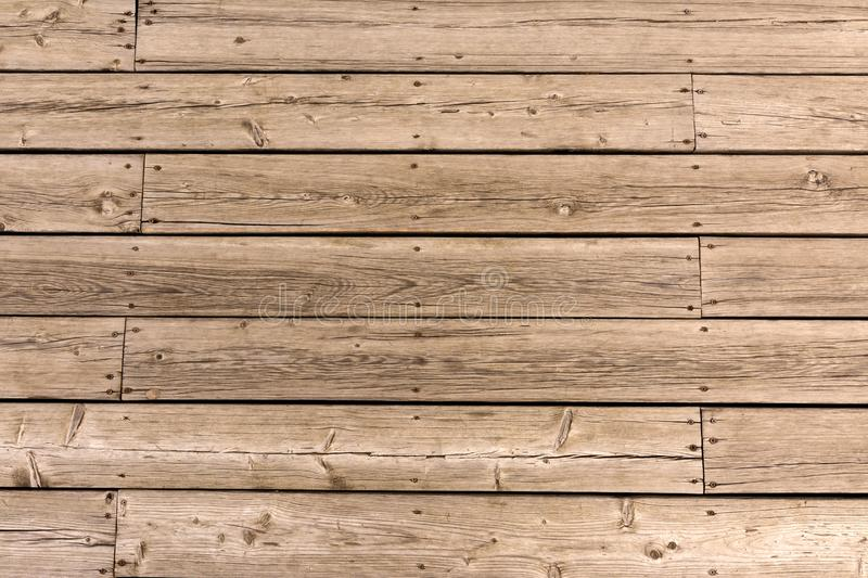 Old wooden floor of crooked boards. Natural wood texture royalty free stock images