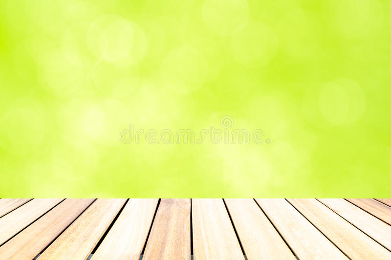 Old wooden floor in front of abstract color bokeh background stock photos