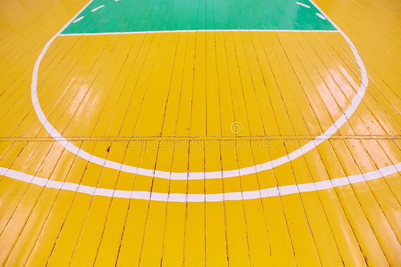 The old Wooden floor of sports hall with marking lines. Background image.  stock photo