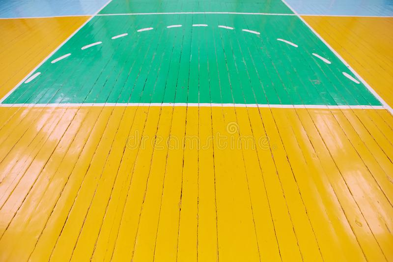 The old Wooden floor of sports hall with marking lines. Background image.  royalty free stock photography
