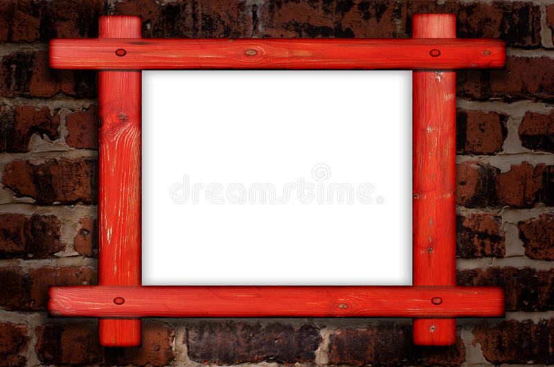 Old wooden frame against a brick wall with copy space in the centre stock images