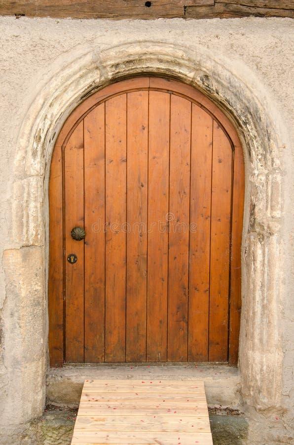 Old wooden front door, Tuebingen, Germany. Old wooden front door in Tuebingen, Bavaria, Germany royalty free stock photo