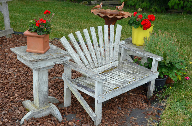 Old wooden garden bench. Old weathered wooden garden bench royalty free stock photos