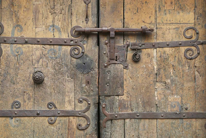 Old wooden gate with an ancient metal lock, Villefranche de Conflent, France stock images