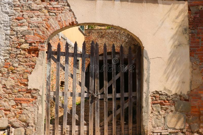 Old wooden gate in an archway stock photography