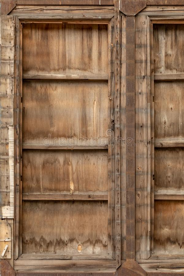 Old wooden gate covered with iron. stock image